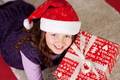 Smiling young girl with a Christmas present Stock Image