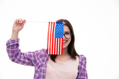 Smiling young girl covering her eye with flag Stock Photo