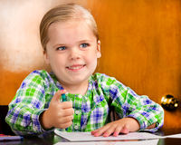 Smiling young girl doing a drawing. Stock Photography