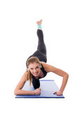 Smiling young girl doing fitness workout Royalty Free Stock Photo