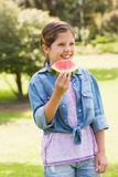 Smiling young girl eating water melon in park Royalty Free Stock Photo