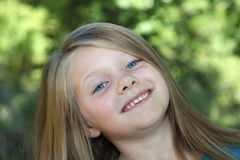 A Smiling Young Girl. A young five year old smiles at the camera Royalty Free Stock Photos