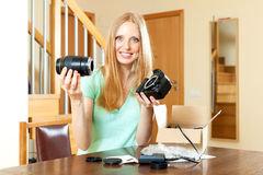 Smiling young  girl fixing the lens with new digital camera  in Stock Image