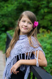 Smiling young girl with flower in the hair Royalty Free Stock Photos