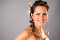 Smiling young girl with flower hairdo visage Stock Photos