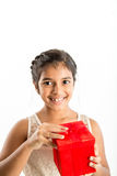 Smiling young girl with gift Stock Image