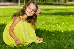 Smiling young girl on the grass Stock Images