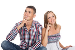 Smiling young girl and guy looking up Royalty Free Stock Images