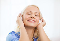 Smiling young girl in headphones at home Royalty Free Stock Photography