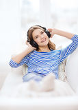 Smiling young girl in headphones at home Royalty Free Stock Image