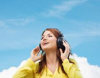 Smiling young girl in headphones at home Royalty Free Stock Photos