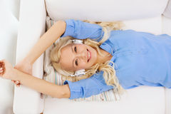 Smiling young girl in headphones at home Royalty Free Stock Photo