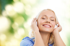 Smiling young girl in headphones outdoors Stock Photo