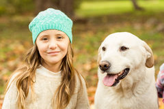 Smiling young girl with her dog Stock Photo
