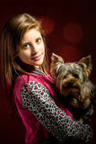 Smiling young girl with her pet yorkshire Royalty Free Stock Photo