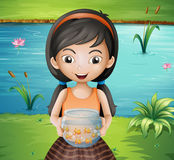 A smiling young girl holding an aquarium Royalty Free Stock Photo