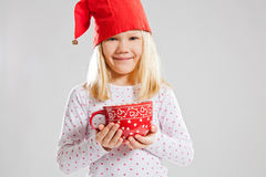 Smiling young girl holding big red cup Royalty Free Stock Photography