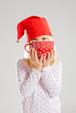 Smiling young girl holding big red cup Royalty Free Stock Photo