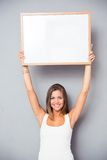 Smiling young girl holding blank board Royalty Free Stock Photos