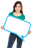Smiling young girl holding blank text bubble in specs Royalty Free Stock Photo