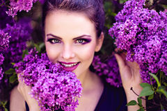 Smiling Young Girl Holding Branch Of Lilac Royalty Free Stock Photo