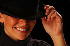 Smiling Young girl holding hat Royalty Free Stock Photography