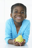 Smiling Young Girl Holding Pear Stock Photos
