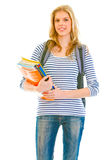 Smiling young girl holding schoolbooks in hands Stock Images