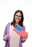 Smiling young girl holding US flag Royalty Free Stock Photo