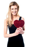 Smiling young girl holding valentine gift Stock Photo