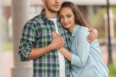 Smiling young girl huging man. Handsome men holding girl close stock images