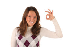 Smiling young girl indicating OK sign (isolated) Stock Photography
