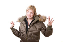 Smiling young girl in a jacket Royalty Free Stock Images