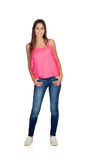 Smiling young girl with jeans standing. Isolated on a white background stock photos