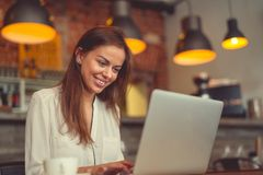 Smiling young girl with a laptop Stock Image