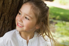 Smiling young girl looking away in park Royalty Free Stock Photography