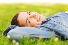 Smiling young girl lying on grass Stock Photo