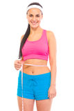 Smiling young girl measuring her waist Royalty Free Stock Image