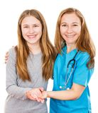 Smiling young girl and pediatrician. Photo of smiling young girl and pediatrician Royalty Free Stock Photos