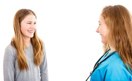 Smiling young girl and pediatrician Royalty Free Stock Photography