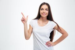 Smiling young girl pointing finger up Stock Photos