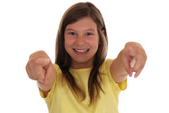 Smiling young girl pointing with her finger I want you Royalty Free Stock Image