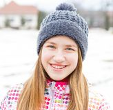 Smiling young girl. Portrait photo of cute smiling young girl Royalty Free Stock Images