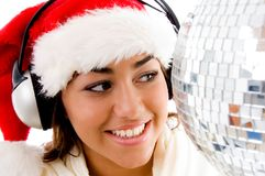 Smiling young girl posing in christmas hat Stock Photos