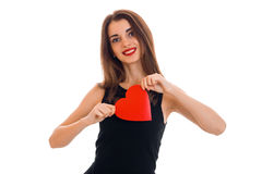 Smiling young girl with red lipstick holds postcard sweetheart Stock Image