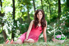 Smiling young girl sitting on the grass Stock Photography