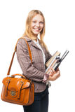 Smiling young girl standing with bag and books Stock Images