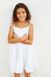 Smiling Young Girl Standing Outdoors Against White Wall Stock Photos