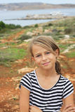 Smiling young girl standing on a view point Royalty Free Stock Photos
