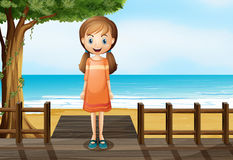 A smiling young girl standing at the wooden bridge Stock Image